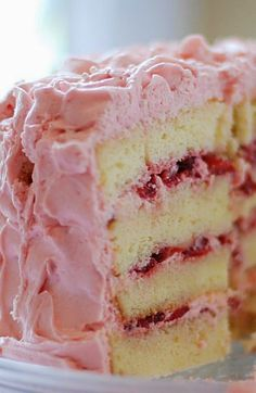 Vanilla Cake with Strawberry Cream Frosting.vanilla cake with strawberry cheesecake filling (all from scratch, no mix). You could use a mix to save time and just add the berries to the mix. If you add an extra egg and a tad of vanilla, it'll make this cake taste more like homemade..