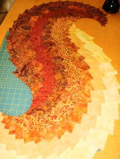 Yesterday I taught my first official Spicy Spiral Table Runner  to a guild class of 18 people.   I'm pleased that everyone finished their Sp...