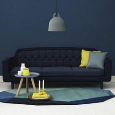 Too much blue altogether, but taken individually, I love the wall color, the couch, and the rug.