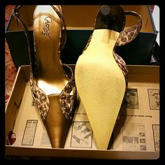 Shoes Tan and gold slingback,  pointed toe I think the heel maybe about 2 inches very cute. Shoes