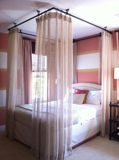 Pictures of the Curtain Hung to Ceiling | Ceiling Curtains around Bed - shows black hardware hung from ceiling, sheer curtains around bed