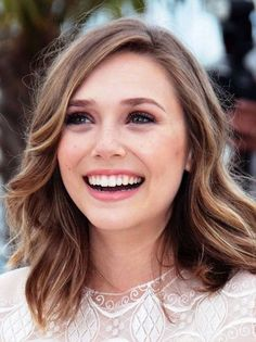 Elizabeth Olsen: The youngest of the Olsen clan, Elizabeth shows that she can have just as much style as her fashionista sisters with this deep side part.