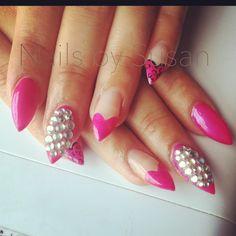 Pink gel nail. Rhinestones.