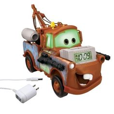"""Cars Alarm Clock Light-Up Storyteller, brown by KIDdesigns, Inc. $39.99. Easy-to-set clock and alarm controls with snooze. Color-changing nightlight. AC adaptor included. Fall asleep listening to stories read by Mater or listen to the FM radio. Wake up to lights, speech and sound effects. From the Manufacturer                """"Hey buddy, you need a tow?"""" Listen to an exciting bedtime story from Mater before you drift off to sleep. Or choose to listen to the FM radio w..."""