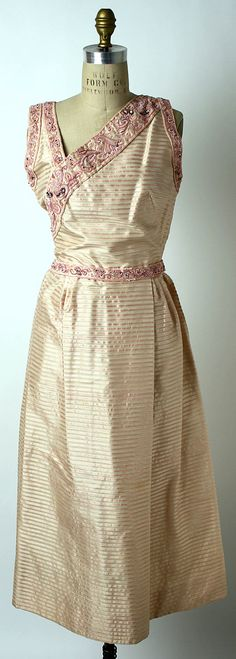 Cocktail Dress.  Mainbocher (American, 1890–1976).  Date: 1953–55. Culture: American. Medium: silk, plastic, glass. Dimensions: Length at CB: 48 1/2 in. (123.2 cm).