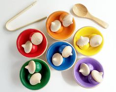 Montessori and Waldorf wooden color sorting, counting, and matching game. This beautiful wooden toddler toy is great for learning colors, early math and counting skills, as well as developing fine motor skills through pretend play. Each set comes with 12 acorns and 6 bowls painted