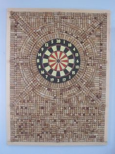Cork Dart Board Wall protector. This is a great idea! No more holes in the walls from my bad throws! by iris-flower