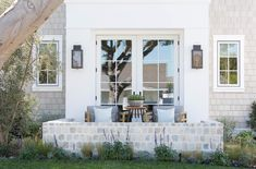 Front porch sitting is made so much better with that tumbled stone shingle combo! . . . Builder: @peteblackci Interior: @brookewagnerdesign Lens: @tostistudios