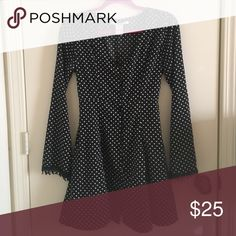Polka Dot Bell Sleeve Dress Bell sleeve dress with polka dot pattern. Ties in the back so you can adjust the waist. Buttons all the way up the front. Lace trim details on the bell sleeves! Size small. American Rag Dresses Mini