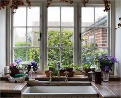 A window above the kitchen's ceramic sink overlooks rose bushes in the entry courtyard....hmmmm....they need to trim those bushes!  At any rate, the sink is gorgeous...love how the window is bumped back.