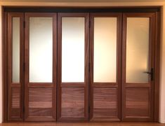 This interior horizontal wood folding door is the perfect blend between classic and modern for this home. #customhomes