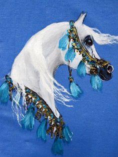 White arabian horse painted on a blue sweatshirt.  $22 on etsy