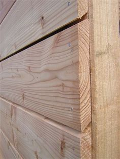 Cladding detail, Scotland : Home grown un-coated Larch positioned heart-side out.