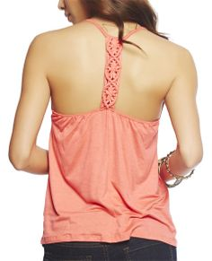 It is all about the details with this tank, featuring an intricate macrome t-back, lightweight slub knit body, ruched scoop neck, spaghetti straps, and a relaxed fit.  Model is 5'9 and wears a size small   95% Rayon / 5% Spandex Hand Wash Imported