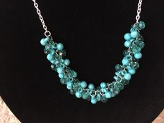 A personal favorite from my Etsy shop https://www.etsy.com/listing/488917532/teal-green-necklace-cluster-bead