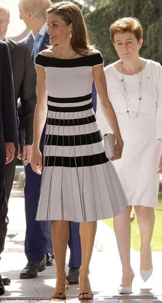 Wearing her hair loose but sleekly styled, the glamorous Spanish royal finished the monochrome look with a smart white clutch bag