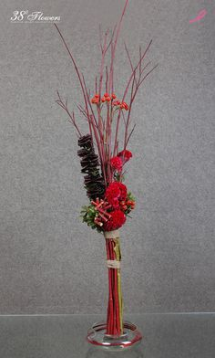 Contemporary Asian Floral Design with Red Dogwood twigs, red coxcomb, red rose hips