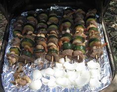 steak, shrimp, zucchini, mushroom and onion kebobs