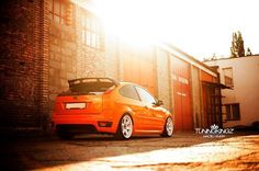 Ford Focus ST II electric orange, white rims, big #RS spoiler