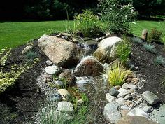 Pondless waterfall cascading over large rock.