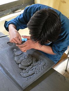 Slate carving at the School of Traditional Arts - Thimphu, Bhutan.