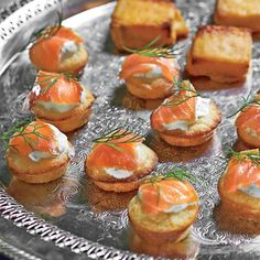 Make these in the morning, and top with salmon and crème fraîche just before your guests arrive. Tight on time? Use store-bought blini...