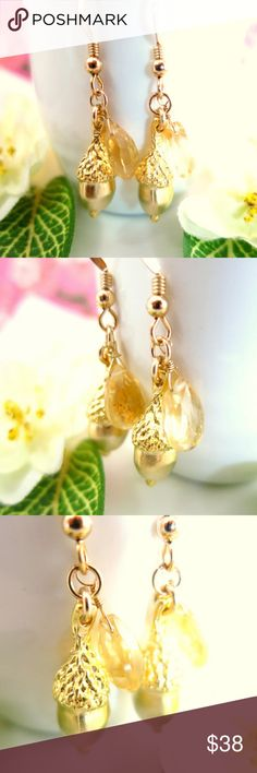 Gold acorn citrine pear briolette dangle earrings This is a pair of cute gold acorn citrine pear briolette dangle earrings. This is a one of a kind jewelry piece. The 10x20mm matte finished acorns are so adorable and are tarnish resistant matte gold plated over brass. I attached with gold filled wire beautiful high quality AAA micro-faceted 7x9mm citrine pear briolettes to the side of the acorn. I love the gorgeous detail of the acorn tops. These earrings come with gold filled ball earring…