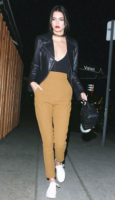Kendall Jenner is edgy in a Balenciaga Leather Biker Jacket with a low cut bodysuit, Givenchy bag, camel trousers and white sneakers