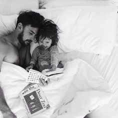 Father and daughter fun in bed