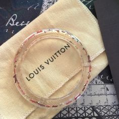 Louis Vuitton inclusion bangle Absolutely beautiful with Swarovski crystals. Authentic. Pink, coral and gold in a clear bangle. Louis Vuitton Jewelry Bracelets