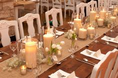 The long tables will have pillar candles in vases at varied heights with clear bud vases with fresh lavender, ivory spray roses, white tulips, and eucalyptus. www.stemfloral.com