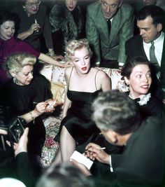 Marilyn Monroe - March 3, 1956 - surrounded by journalists, as she hosts a press party organised by Look Magazine on her upcoming film Bus Stop, held at her home in Los Angeles, California.