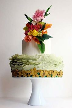 oh my. this is truly a work of art. the petal detail of the green layer is so unique and acts as a little pillow to the cake on top. love. it.