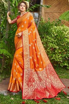Orange banarasi silk saree with red silk blouse, embellished with woven zari. Saree with Round Neck, Half Sleeve. It comes with unstitch blouse, it can be stitched 32 to 44 sizes. #orange #banarasi silk #saree #blouse #Andaazfashion #UK