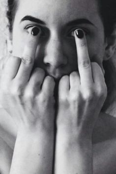 Visually interesting photograph. Creates an illusion with the woman's fingernail polish. Humorous also