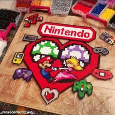 """""""Nintendo is for Lovers"""" - Perler  bead wreath designed and made by  ig_retro4everything_"""