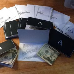 A year worth of surprises for a wedding gift. Each month has a typed idea of something for a date night secured to the inside of note cards with the initial of the last names of the bride and groom alternated. Also included is the cash to have each date night. Chopped challenge ideas, picnic in the park, even a hike with the pups and money for high energy snacks.