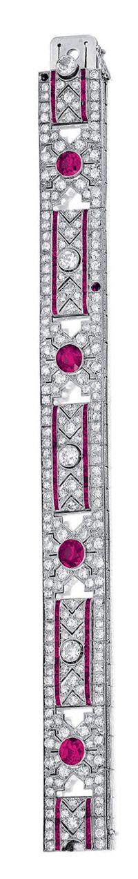 RUBY AND DIAMOND BRACELET,  EARLY 20TH CENTURY.  Of open work design, millegrain-set with four circular-cut rubies and similarly cut diamonds, accented with calibré-cut ruby and diamond set geometric surrounds, to the scroll engraved gallery, mounted in platinum