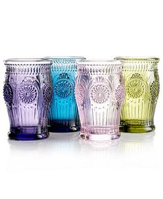 Could use these as vases or drinking glasses.  Love colored glass.