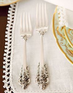 Chris Barrett Design featured in Traditional Home. Wallace estate silver and linen placemats with beaded trim.