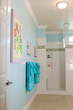 Love the idea of painting the walls this color with this artwork to take away from our pink tub and toilet..
