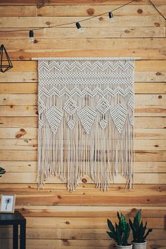This macrame is an amazing boho wedding backdrop. It is truly a piece of art. It has thin lines, grapes pattern and a retro feel. Besides your big day, this extra large macrame wall hanging will make it a perfect statement piece in a modern bohemian, Scandinavian or contemporary home.