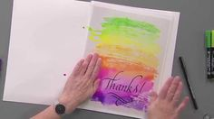 Joanne Fink demonstrates how to create Beautiful Background washes for cards and artwork using Koi Coloring Brush pens from Sakura. After that she adds lettering using Pigma Calligrapher pens.