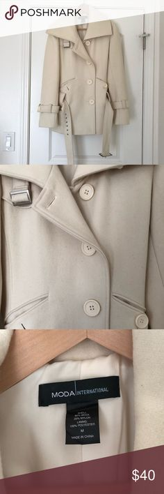 MODA Cream Pea Coat with belt A gorgeous cream peacoat with belt to add shape. It has pockets for keepsakes and things and is so incredibly warm! Size Medium! Worn a couple times, but in great condition!! Moda International Jackets & Coats Pea Coats