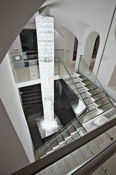 """A trip up to the first floor of Swarovski Kristallwelten Store Innsbruck will take you up a vast crystal staircase, which is made of more than crystals and is lit from underneath by the """"Cascade"""" chandelier, created by Vincent van Duysen for Swaro Innsbruck, Mansion Interior, Unusual Homes, Room Goals, Decorating Tips, Luxury Homes, Swarovski, Hotels, New Homes"""
