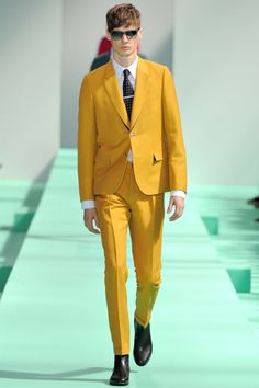Be daring in this mustard yellow Paul Smith SS 2013 suit.  Mustard yellow is one of my favorite colors to wear, particularly for its timeless and understated boldness.  I also think this color can be very versatile, since it can be incorporated with other pieces if coordinated correctly.  My tip is; stick to its rightful color palette and or play with different shades of yellow. But when in doubt, incorporate neutrals such as: white, beige, black, brown, gray, etc. Moreover, musta