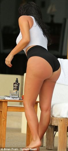 Kim Kardashian cools off in see-through bathing suit in photos from Mexico honeymoon   Mail Online