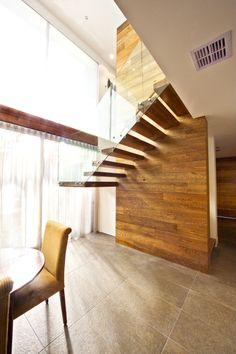 American Oak | Stained | Closed | Cantilevered | Stair | Design | Glass Balustrade | Feature | Concealed Steel String | Half Space Landing