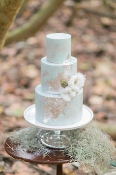 wedding cake with cotton - photo by Karla Korn Photography http://ruffledblog.com/overcast-beach-wedding-with-blues-and-silver