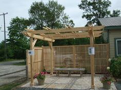 White cedar pergola with Stonebridge styled fence screening.  Supplied and installed by Lanark Cedar.